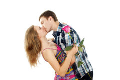 Guy hugs a girl with a rose Royalty Free Stock Images