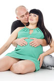 Guy hugs a pregnant girl in the form of heart Royalty Free Stock Photography