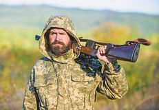 Guy hunting nature environment. Bearded hunter rifle nature background. Harvest animals typically restricted. Hunting. Hobby concept. Experience and practice royalty free stock photography