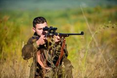 Guy hunting nature environment. Hunting weapon gun or rifle. Hunting target. Masculine hobby activity. Experience and. Practice lends success hunting. Man stock photography