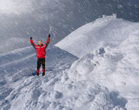 Guy with an ice pick in the mountains Stock Photos