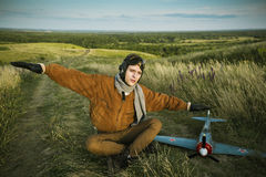 Free Guy In Vintage Clothes Pilot With An Airplane Model Outdoors Stock Image - 42721211