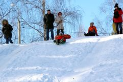 The guy from India, the first time riding on a sled. royalty free stock photos