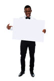 Guy indicating towards blank whiteboard Royalty Free Stock Images