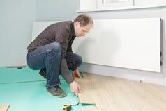 Guy installing flooring Stock Photos