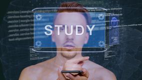 Guy interacts HUD hologram Study. Young man interacts with a conceptual HUD hologram with text Study. Guy with future technology mobile screen on background of stock video