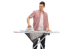 Guy ironing a t-shirt Stock Photography