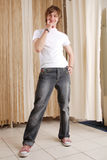 Guy in jeans. A thoughtful guy in jeans Royalty Free Stock Image