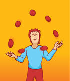 Guy juggling balls in the air Royalty Free Stock Photography
