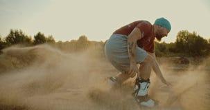Guy jumping on sandboard in desert