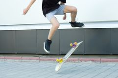 Guy is jumping on a skateboard up. Lubricated motion stock photos