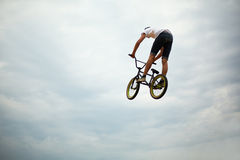 Guy jumps on bike royalty free stock photos