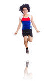 Guy jumps with skipping rope isolated on white. Guy jumps with skipping rope on white royalty free stock photo