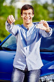 Guy with keys and driving license Stock Image