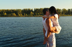 The guy kiss the girl on the background of beautiful scenery Royalty Free Stock Images