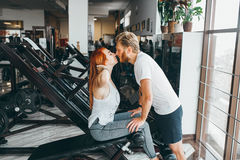 Guy kiss girlfriend on training in gym Royalty Free Stock Image