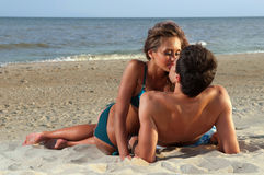 Guy kiss his girlfriend. On the beach Stock Image