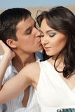 Guy kisses girl Stock Image