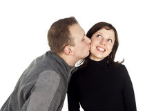 Guy kisses a girl Royalty Free Stock Image