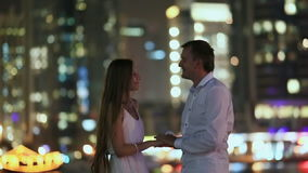 The guy kisses the hand of his girlfriend in the night Dubai.  stock video footage