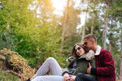 Guy kisses his girlfriend in the forest Stock Photo