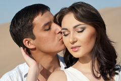 Guy kissing a beautiful girl Stock Photography