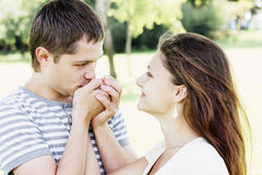 Guy kissing girfriends hands Stock Photography