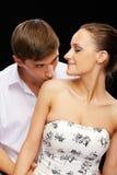 Guy kissing girls shoulder Royalty Free Stock Photo