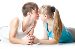 A guy is kissing his girlfriend Stock Images