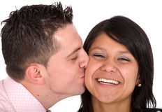 Guy kissing his girlfriend Royalty Free Stock Images