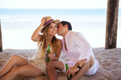 Guy kissing his girlfriend on her cheek Stock Photos