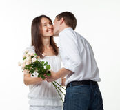 Guy kissing his smiling girlfriend Stock Image