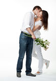 Guy kissing his smiling girlfriend Royalty Free Stock Photos