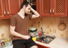 Guy in the kitchen doing the dishes Stock Photos