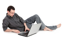 Guy with the laptop isolated on a white background Royalty Free Stock Photo