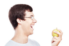 Guy laughing with apple Royalty Free Stock Image