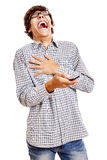 Guy laughing with phone Royalty Free Stock Photo