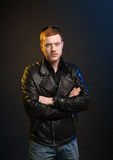 Guy in leather jacket on a dark background Stock Photography
