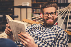 Guy in the library Stock Photography