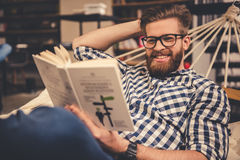 Guy in the library Stock Photo