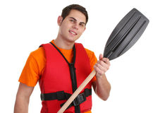 Guy with lifejacket. Guy with a lifejacket and a oar Stock Photography