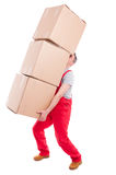 Guy lifting or holding bunch of heavy cardboard boxes. Full body of guy lifting or holding bunch of heavy cardboard boxes isolated on white background Stock Images