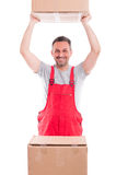 Guy lifting or holding up cardboard box. And smiling isolated on white background Royalty Free Stock Images