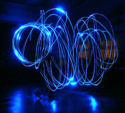 Guy with light. Performances guy with blue light. Light painting photo Stock Image