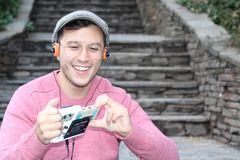 Guy listening to Stereo cassette Walkman in the 80s or the 90s.  royalty free stock photography