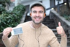 Guy listening to Stereo cassette Walkman in the 80s or the 90s.  stock image