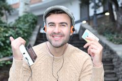 Guy listening to Stereo cassette Walkman in the 80s or the 90s.  stock images
