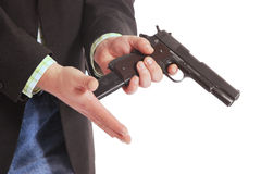 Guy loading gun Stock Images