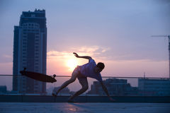 Guy on a long board Stock Image