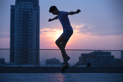 Guy on a long board Royalty Free Stock Images